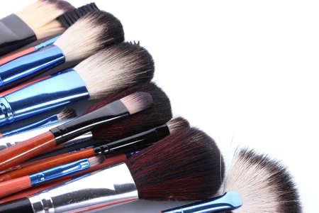 make-up brushes isolated on white photo