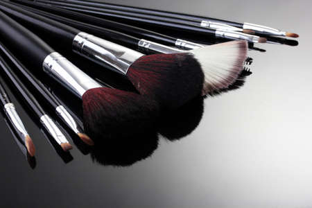 makeup a brush: make-up brushes on grey background