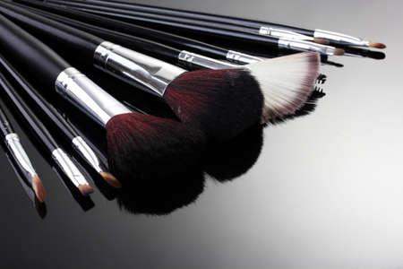 applicator: make-up brushes on grey background