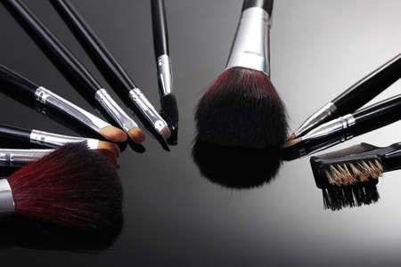 make-up brushes on grey background Stock Photo - 13163277