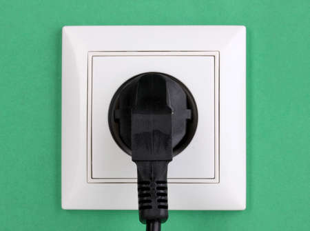 White electric socket with plug on the wall Stock Photo - 13163154