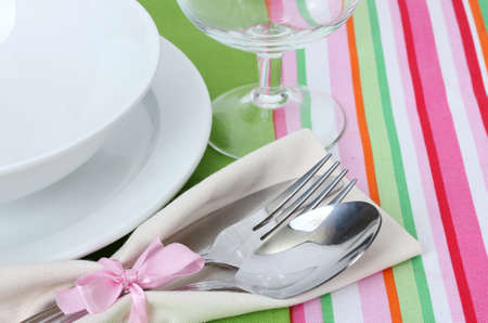clean dishes: Table setting with fork, spoon, knife, plates, and napkin
