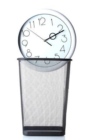 Wall Clock in metal trash bin  isolated on white photo