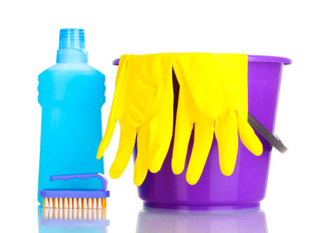 Detergent and bucket with gloves isolated on white photo