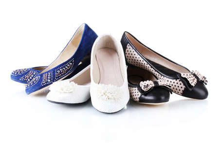 fashion shoes: several pairs of female flat shoes isolated on white