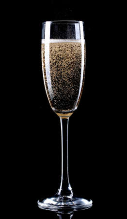 champagne flutes: glass of champagne on black background Stock Photo