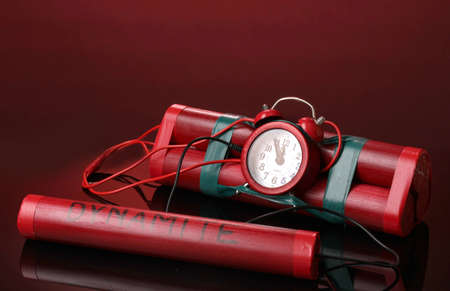 Timebomb made of dynamite on red background Stock Photo - 13213797