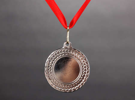 Silver medal on grey background photo