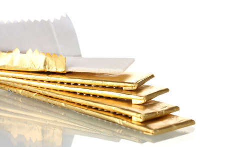 chewing gums wrapped in golden foil, isolated on white Stock Photo - 13234318