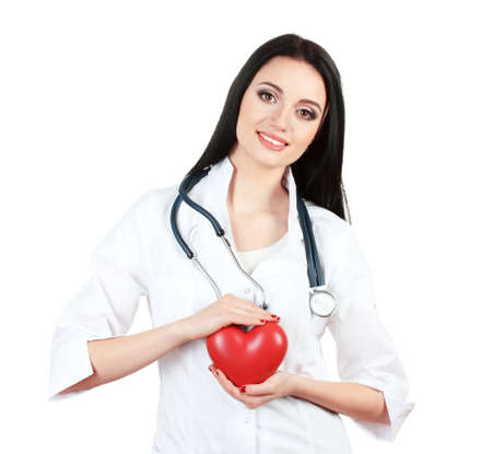 young beautiful doctor with stethoscope holding heart  isolated on white  photo