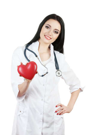 young beautiful doctor with stethoscope holding heart  isolated on white  Stock Photo - 13446752