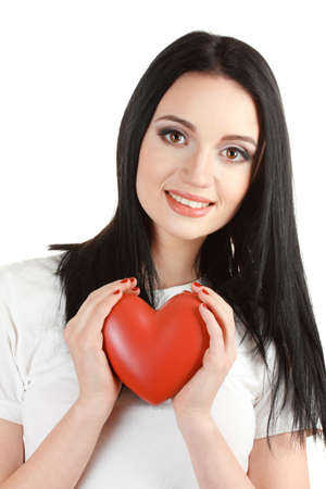 beautiful young girl holding red heart isolated on white photo