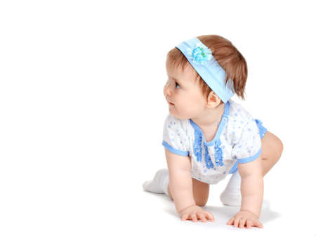 Cute baby girl crawling isolated on white Stock Photo - 13456223