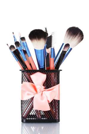 make-up brushes in holder isolated on white photo