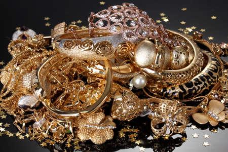 fashion jewelry: Beautiful golden jewelry on grey background Stock Photo