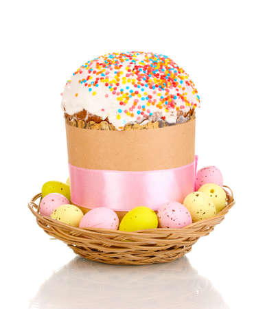 Beautiful Easter cake in basket with eggs isolated on white photo