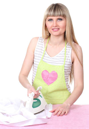 Beautiful young housewife ironing isolated on white photo