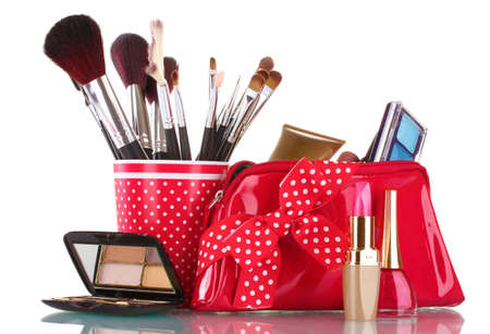 red glass with brushes and makeup bag with cosmetics isolated on white Stock Photo - 13245387