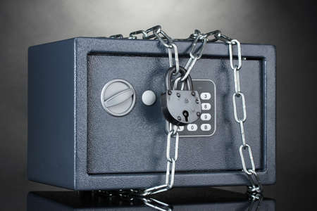 safe with chain and lock on grey background Stock Photo