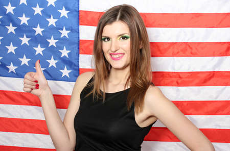 beautiful young woman with the American flag on the background Stock Photo - 13245313