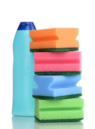 Dishwashing liquid and sponges isolated on white photo