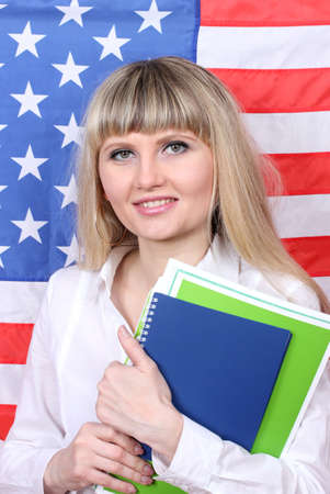 Young woman on the background of the flag of America Stock Photo - 13446600