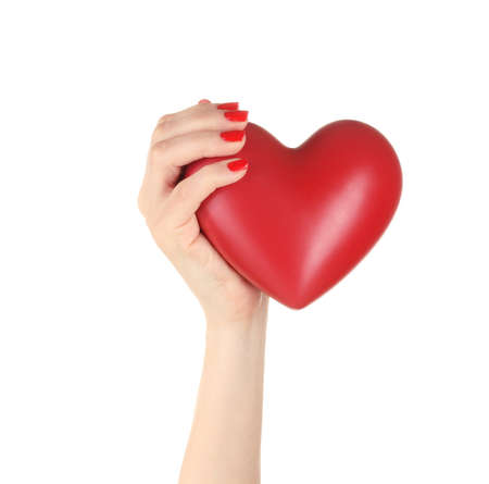 Red heart in woman's hand isolated on white Stock Photo - 13275321