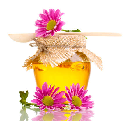 Sweet honey in jar with drizzler isolated on white Stock Photo - 13275714