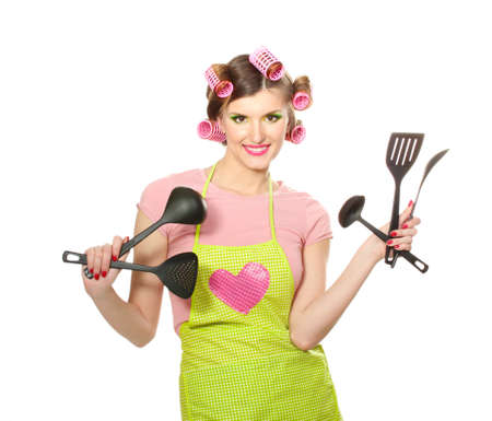beautiful young housewife with kitchen utensils  isolated on white photo