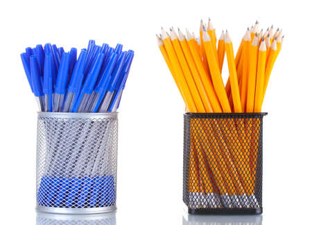 lead pencils and pens in metal cups isolated on white photo