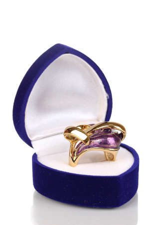 precious gem: Gold ring with violet pattern in blue velvet box isolated on white