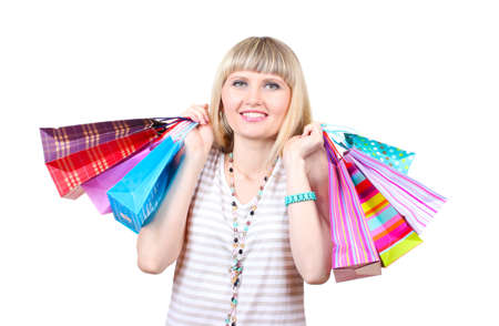 Beautiful young woman with shopping bags isolated on white Stock Photo - 13446642