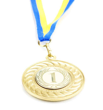 Gold medal isolated on white Stock Photo - 13292946