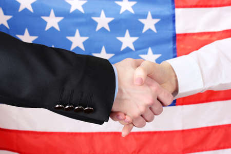 Business handshake on american flag background photo