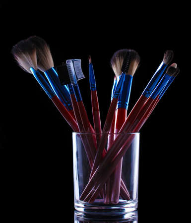 make-up brushes in glass cup on grey background Stock Photo - 13304254