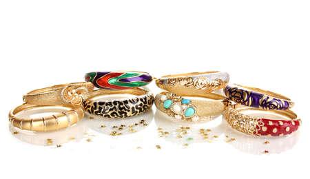 Elegant and fashion golden bracelets isolated on white background photo