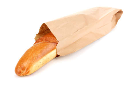 Aromatic baguette in paper bag isolated on white photo