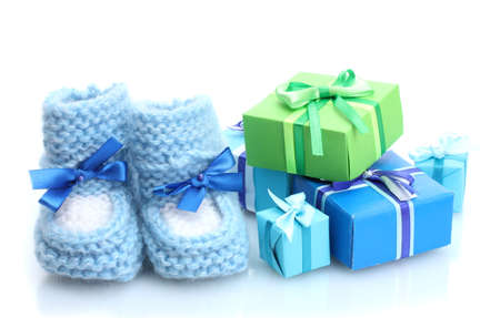 beautiful gifts and baby's bootees isolated on white Stock Photo - 13304303