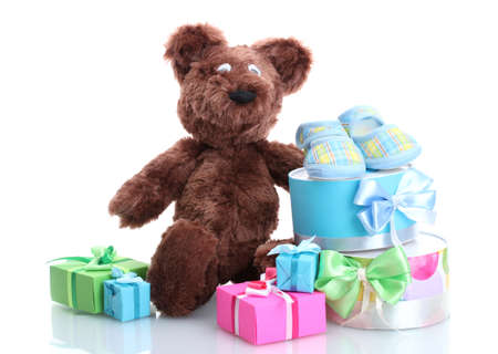 bootees: beautiful gifts, babys bootees and bear toy  isolated on white