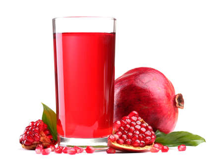 ripe pomergranate and glasses of juice isolated on white  photo