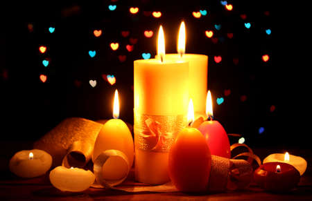 Beautiful candle and decor on wooden table on bright background Stock Photo - 13355904