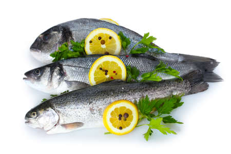 Fresh fishes with lemon, parsley and spice isolated on white Stock Photo - 13356098