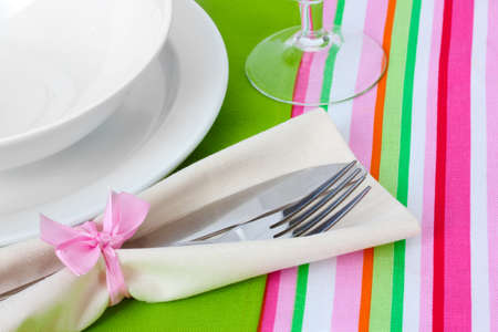 Table setting with fork, knife, plates, and napkin Stock Photo - 13356226