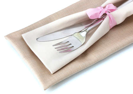 fork and knife on napkin isolated on white photo