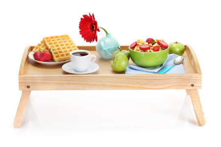 'bedside table': light breakfast on wooden tray isolated on white