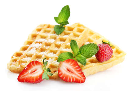 belgium waffles with strawberries and mint  isolated on white photo