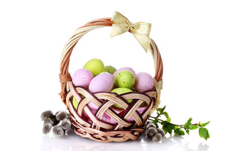 basket with Easter eggs and pussy-willow twigs isolated on white Stock Photo - 13355983