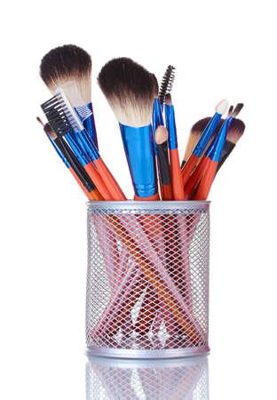 make-up brushes in holder isolated on white photo