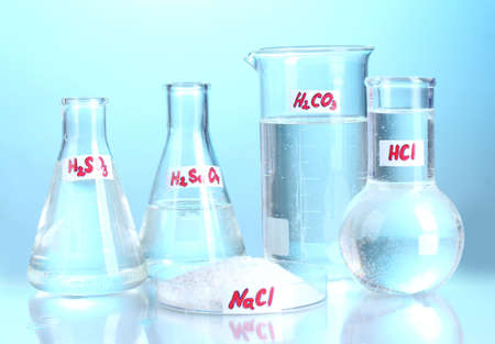 Test-tubes with vaus acids and chemicals  on blue background Stock Photo - 13356010