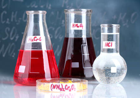 Test-tubes with various acids and other chemicals on the background of the blackboard Stock Photo - 13356103